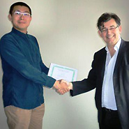 Xi Chen receiving his prize