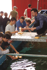 Students gather round Engineering's wave tank to test their designs