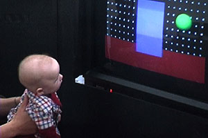 An infant participating in a study of object perception