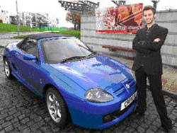 Lee Crossley with the car he bought after founding his own business