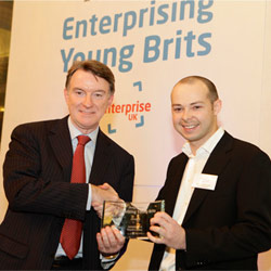 Lord Peter Mandelson presents the award to Antony Chesworth