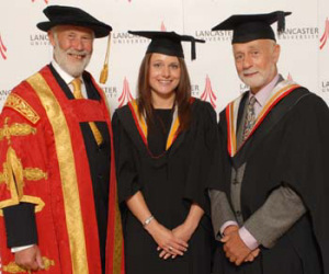 Chancellor Sir Chris Bonington congratulates Sarah Evans and Peter Standing