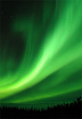 The northern lights: charged particles from the sun interacting with the Earth's atmosphere