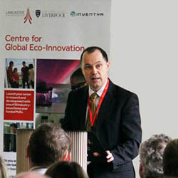 Vice Chancellor Mark E. Smith congratulates the businesses, graduate researchers and academic staff involved