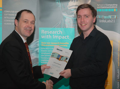 Vice-Chancellor Mark Smith presents a certificate for the Summer Placement Scheme to Harrison Fleetwood
