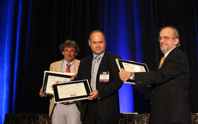 Peter Erdi, Plamen Angelov, and Daniel Levine receiving their awards for outstanding service at the IJCNN 2013. Photo by Wentao Guo.