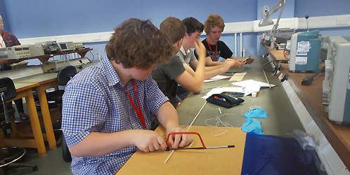 Visiting school pupils design bridges in the Engineering workshop