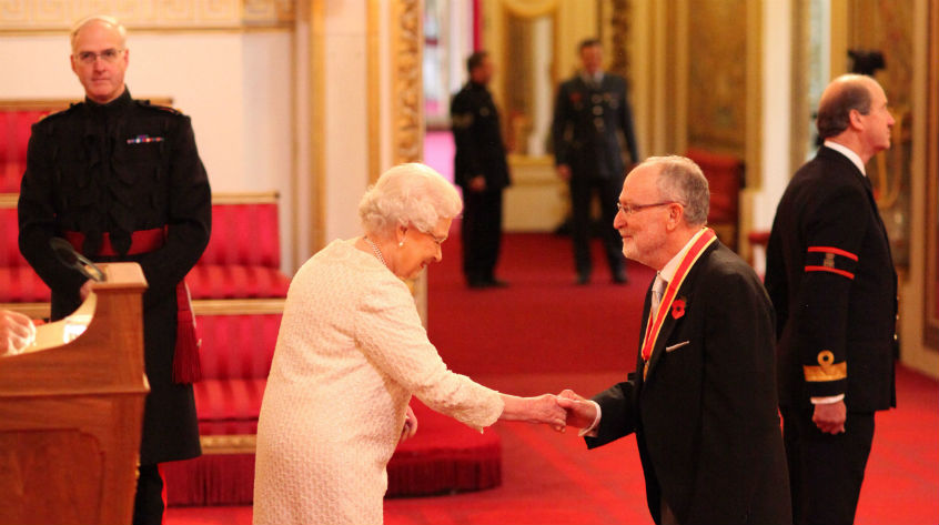 Professor Cary Cooper with Her Majesty The Queen at Buckingham Palace.