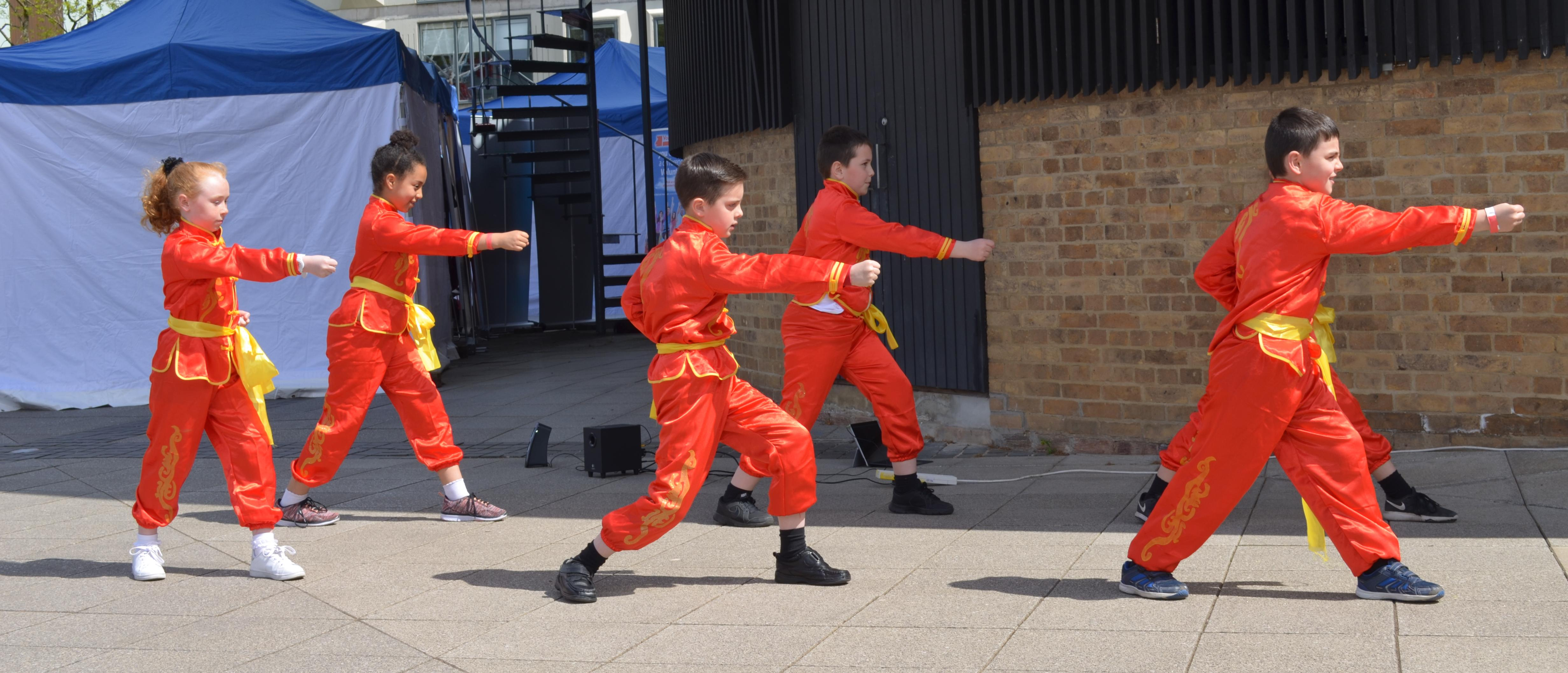 Pupils from a Confucius Classroom perform Wu Shu at Community Day