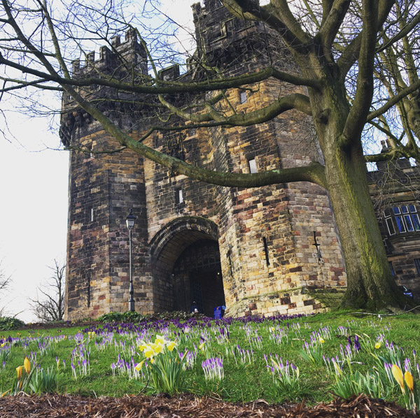 Lancaster Castle with flowers in the foreground