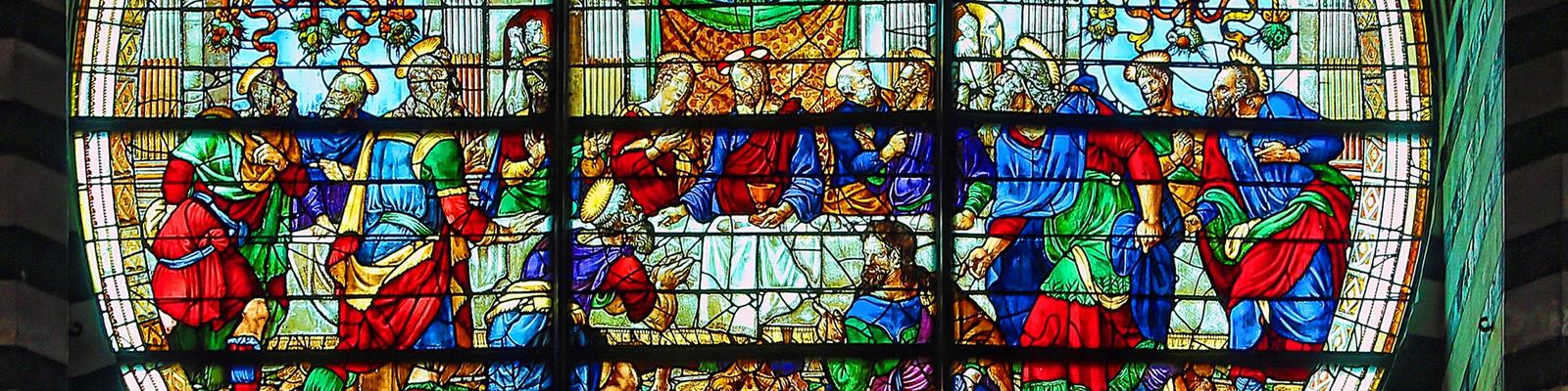 Stained glass window showing religious scene