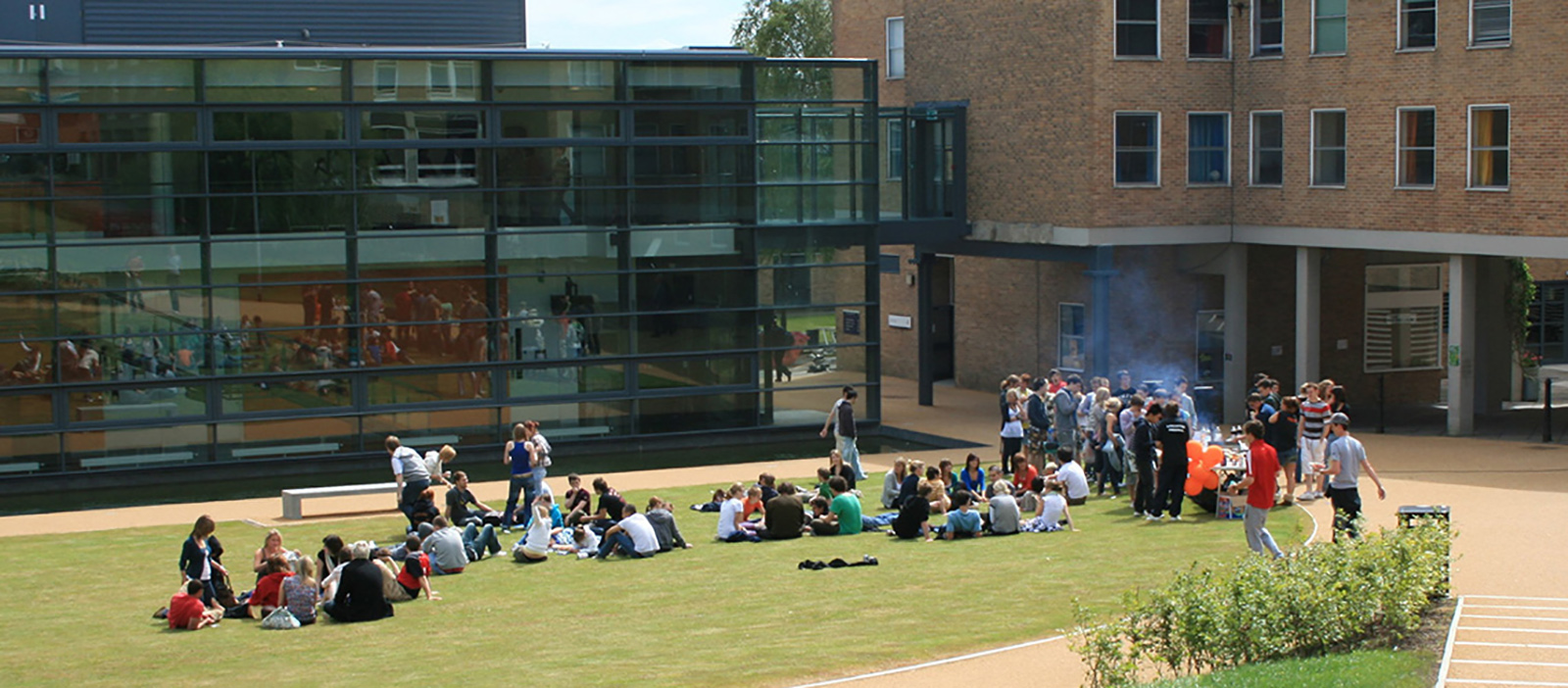 Students at a barbecue outside Fylde College