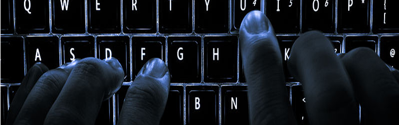 Image showing hands typing in the dark on a backlit keyboard