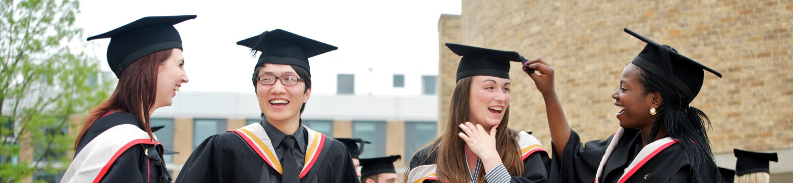 Graduating students enjoy a conversation