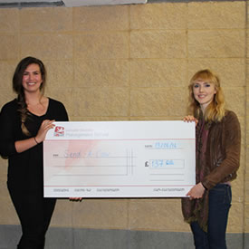 Students pose with their cheque