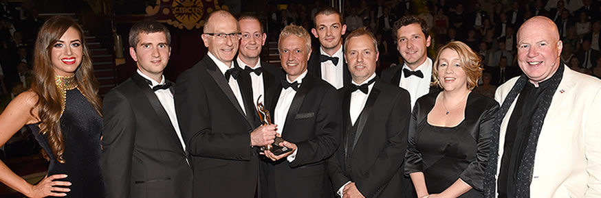 TNP being presented with the BIBA New Business of the Year Award by Kevin Roberts, CEO of Saatchi & Saatchi (far right)