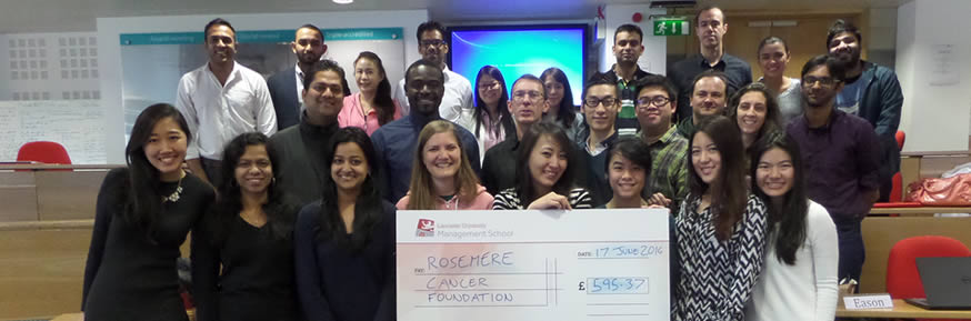 MBA students with their cheque