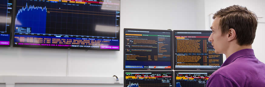 A student examines stock market data in the Bloomberg suite