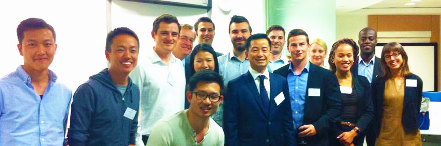 Eric Sim with attendees at his event in London.