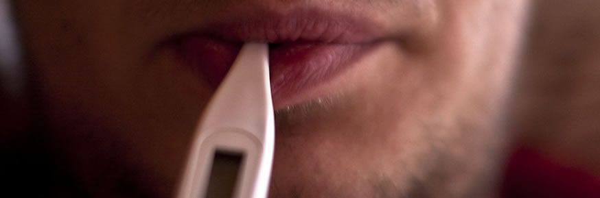 Man with a thermometer in his mouth