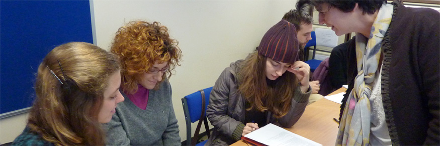 Dr Judit Kormos (right) teaching