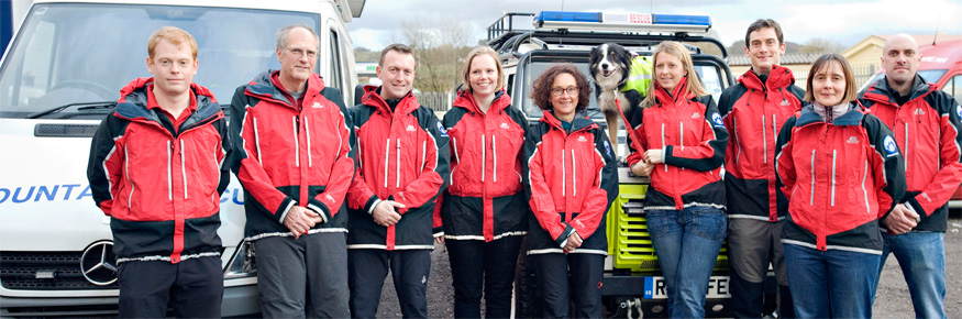 Photograph of nine of the twelve Lancaster University alumni, who are also members of the Bowland Pennine Mountain Rescue Team.