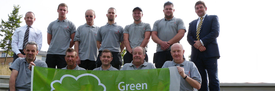 Picture shows team being presented with Green Flag Award