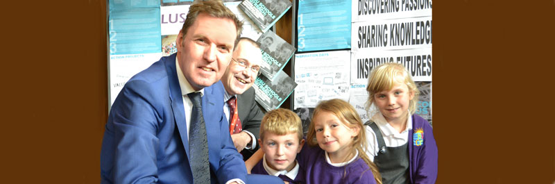 Alan Milburn and the Vice-Chancellor with pupils from Morecambe Bay Community Primary School
