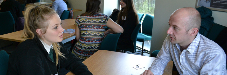 FASS PhD student Oliver Thorne discussing research into RE with Gemma Winter from Queen Elizabeth School in Cumbria.