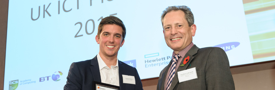 Jonathan Roberts being congratulated by Jonathan Legh-Smith, Head of Strategic Research at BT.