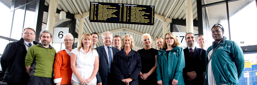 Representatives from Lancaster City Council's Overview and Scrutiny Committee, United Utilities, Lancaster University and Stagecoach unveil a new information board at Lancaster Bus Station