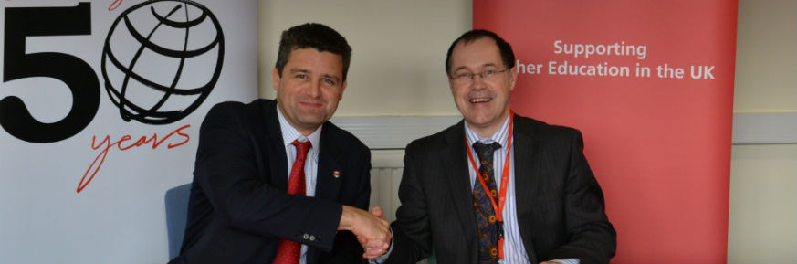 Santander Supports 'Once in a Lifetime Experience' - Vice-Chancellor, Professor Mark E. Smith and Simon Bray, Director of Santander Universities put pen to paper on a renewal of the bank's philanthropic support for Lancaster students