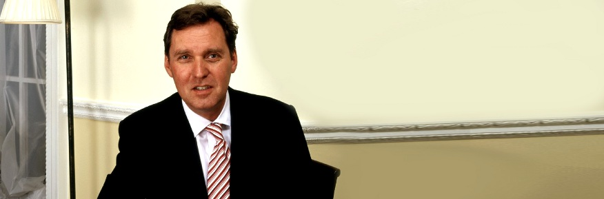 From Council Estate to Cabinet - An Interview with Alan Milburn - Alan Milburn sitting in office