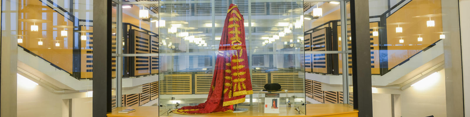 Lancaster University Chancellor's robes in glass cabinet within the Library building
