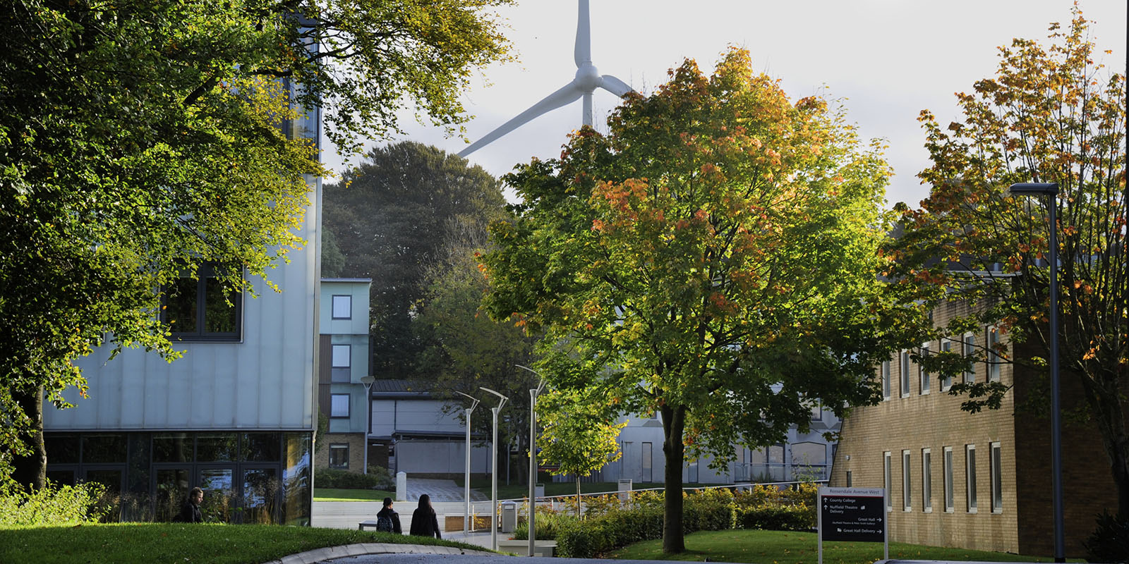 LICA building in autumn with wind turbine in background