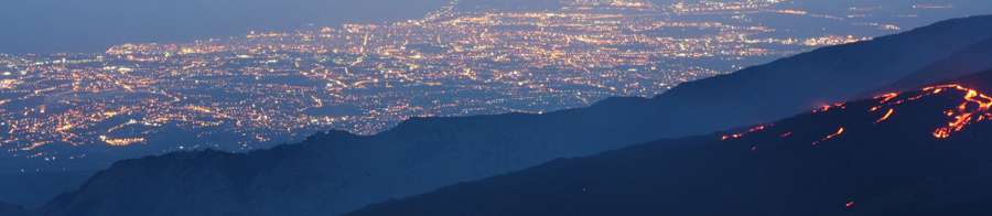 Etna flows in front of the lights of Catania